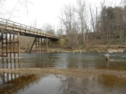 Emma Garschagen wades into the Kokosing River at an access point near Millwood, Ohio. She and her partner Sarah Dendy are taking water samples to test for coliform bacteria and examine river health.