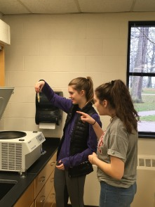Lauren Limbach and Samantha Hayes pellet their E. coli cells